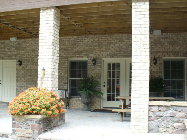 Home Theater and Outdoor Sound System traditional-porch