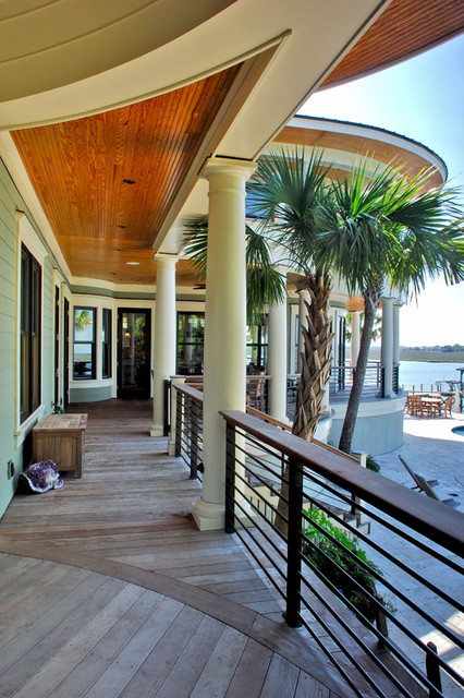 Horizontal railing adds to nautical feel of porch tropical porch