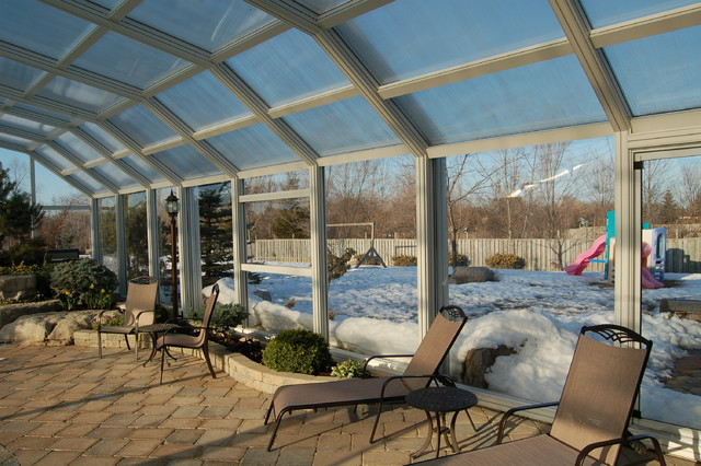 Indoor Pool Setting with our Retractable Pool Enclosures traditional-porch