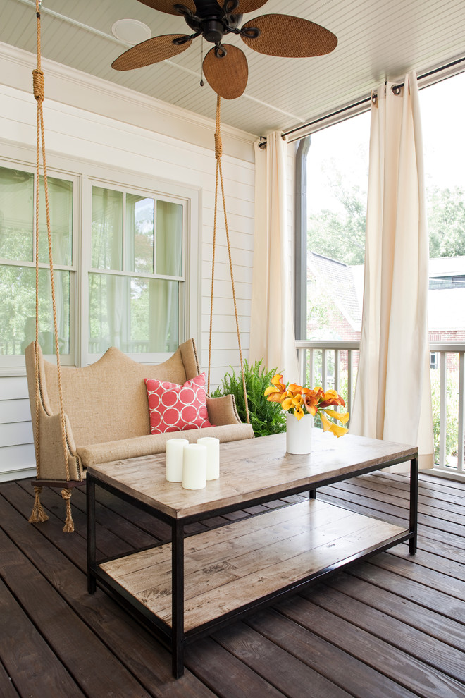 Inspiration for a transitional porch remodel in Atlanta with decking