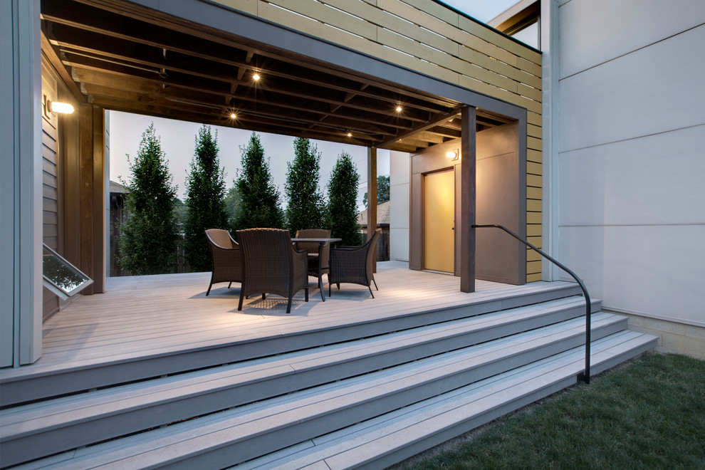 Small minimalist back porch idea in Indianapolis with decking and a roof extension