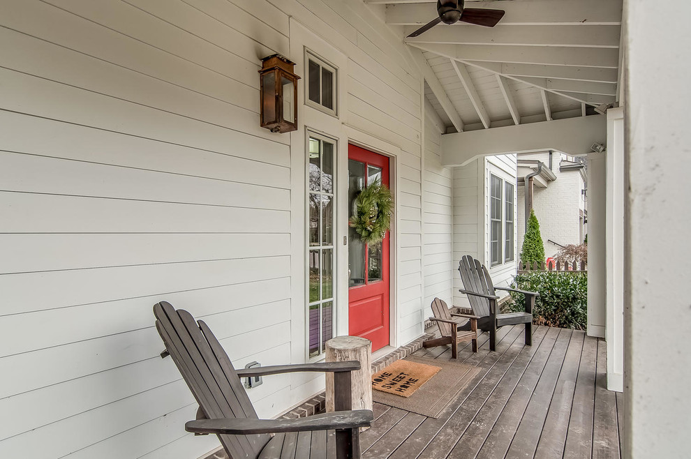 Cottage front porch photo in Nashville with decking and a roof extension