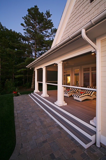 Lakefront living traditional porch grand rapids by for Motorized retractable screens for porches