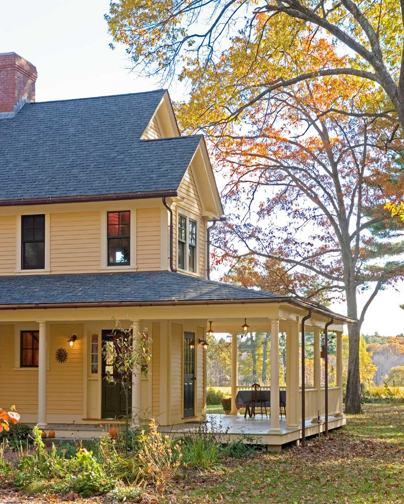 Inspiration for a farmhouse porch remodel in Boston with a roof extension