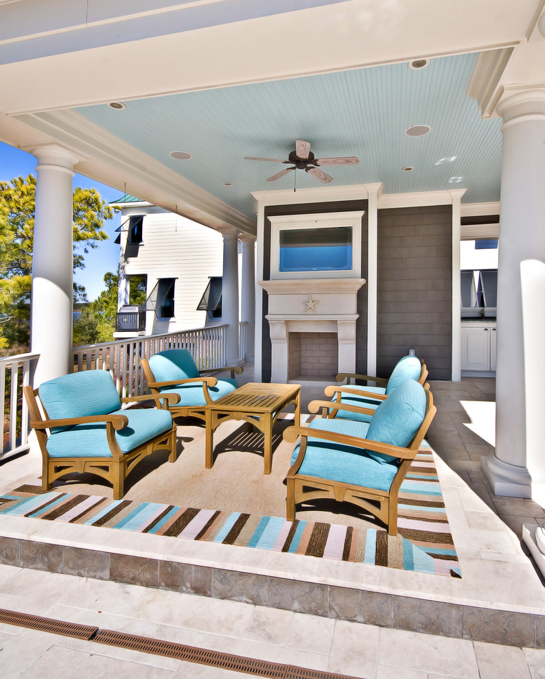 Elegant porch photo in Charleston with a fire pit and a roof extension