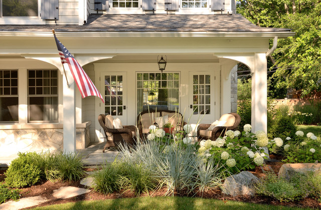 Lovely renovations traditional porch chicago by for Front porch landscaping plants