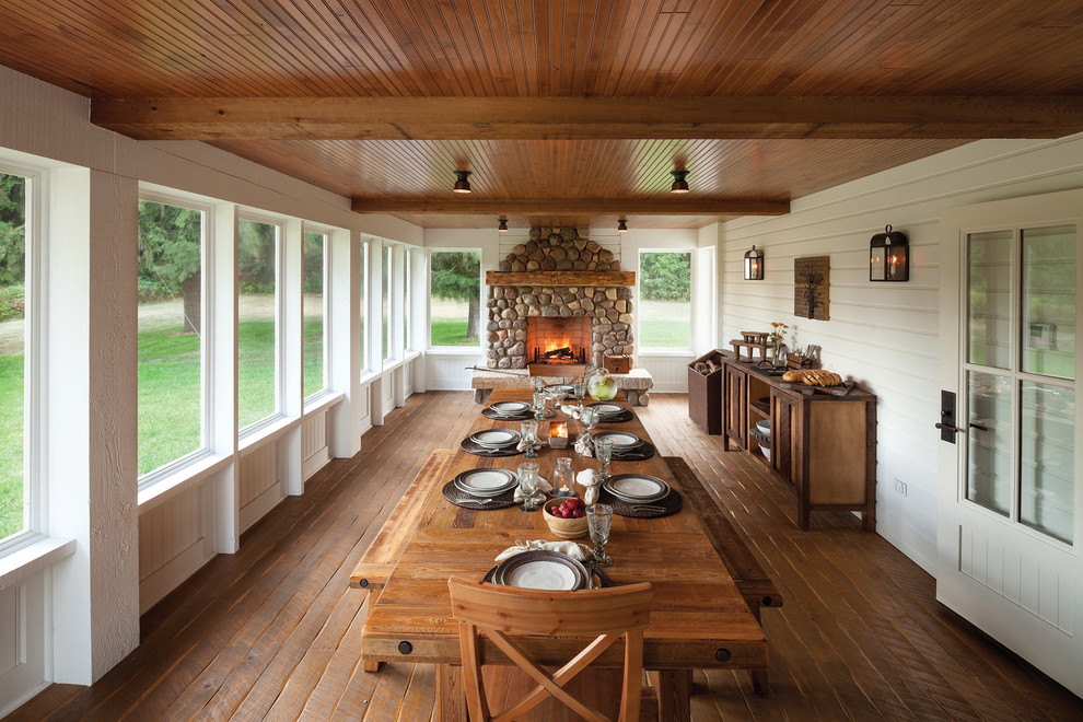 Country screened-in porch idea in Other with decking