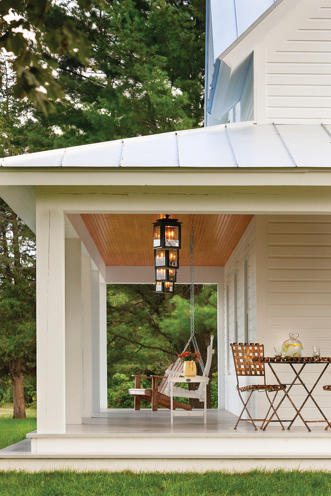 Farmhouse porch idea in Other with a roof extension