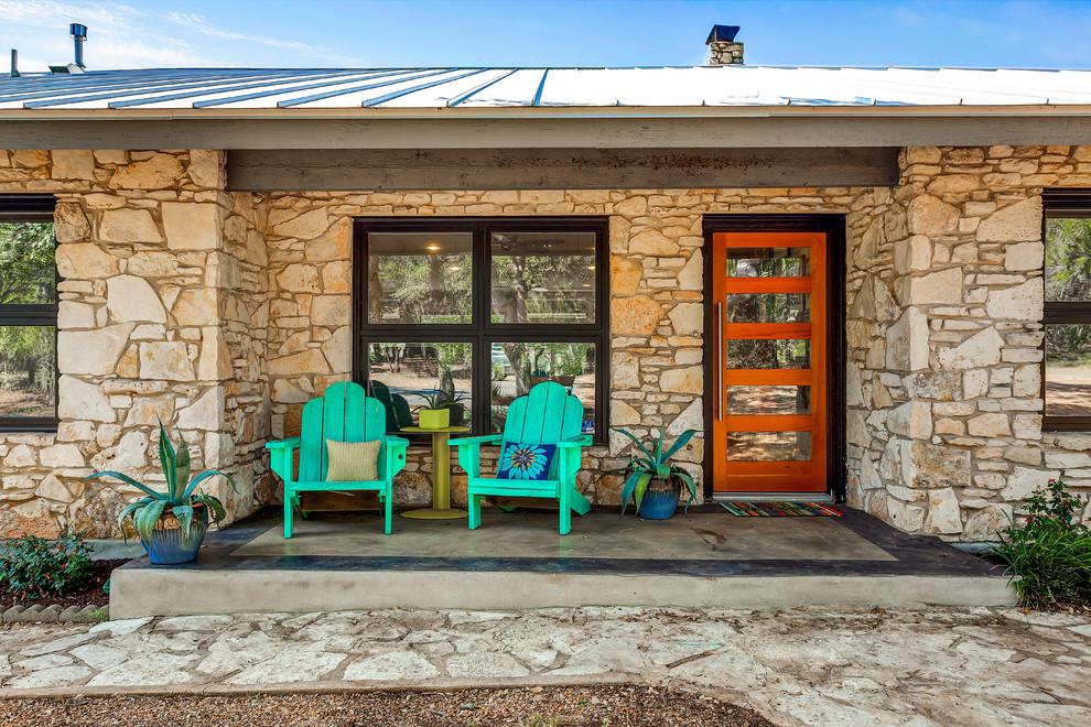 Small transitional concrete front porch idea in Austin