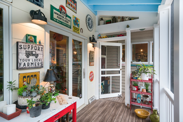 Inspiration for a small eclectic back porch remodel in Columbus with a roof extension and decking