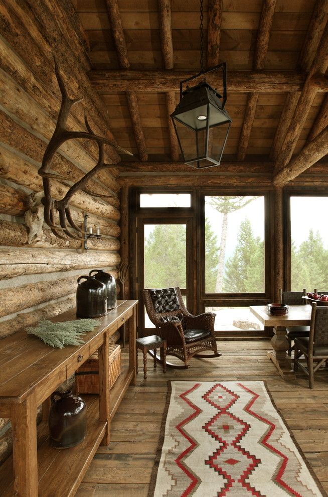Inspiration for a large rustic front porch remodel in Other with a roof extension