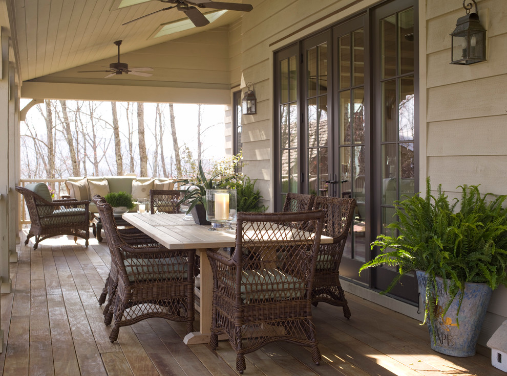 Inspiration for a large timeless side porch remodel in Raleigh with a roof extension
