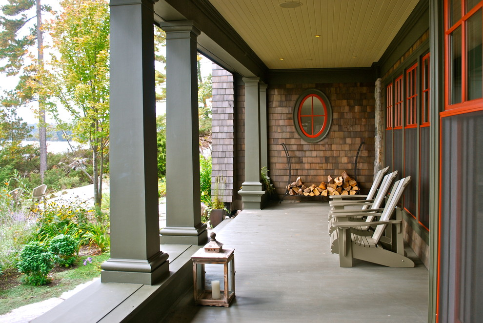 Beach style porch idea in Toronto with a roof extension
