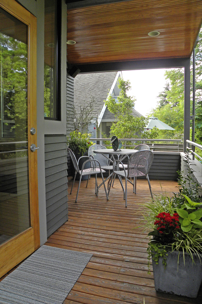 This is an example of a craftsman porch design in Seattle with decking.
