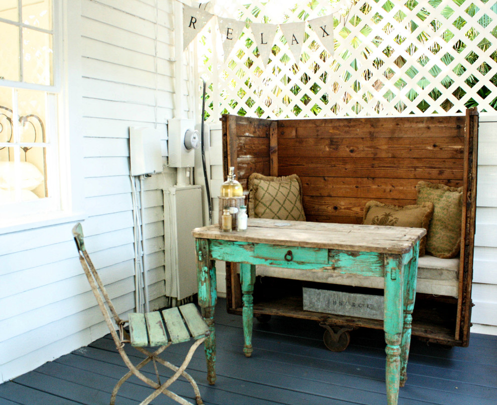 This is an example of a shabby-chic style porch design in Tampa with decking.