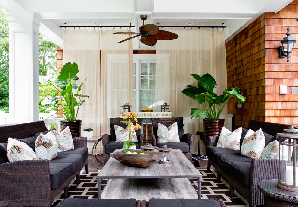 Inspiration for a tropical porch remodel in New York with decking and a roof extension