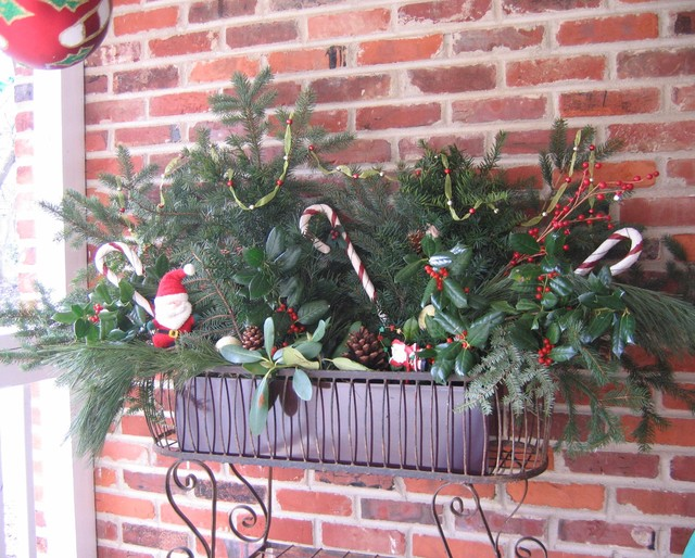 Outdoor Christmas Floral Arrangment eclectic-porch