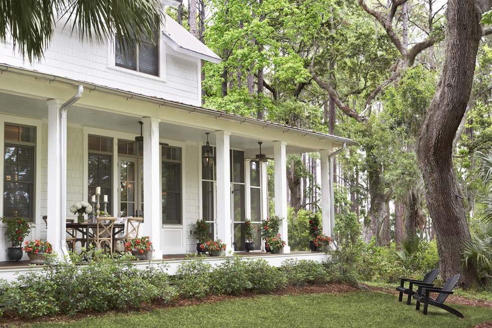 Large classic porch idea in Charleston with a roof extension