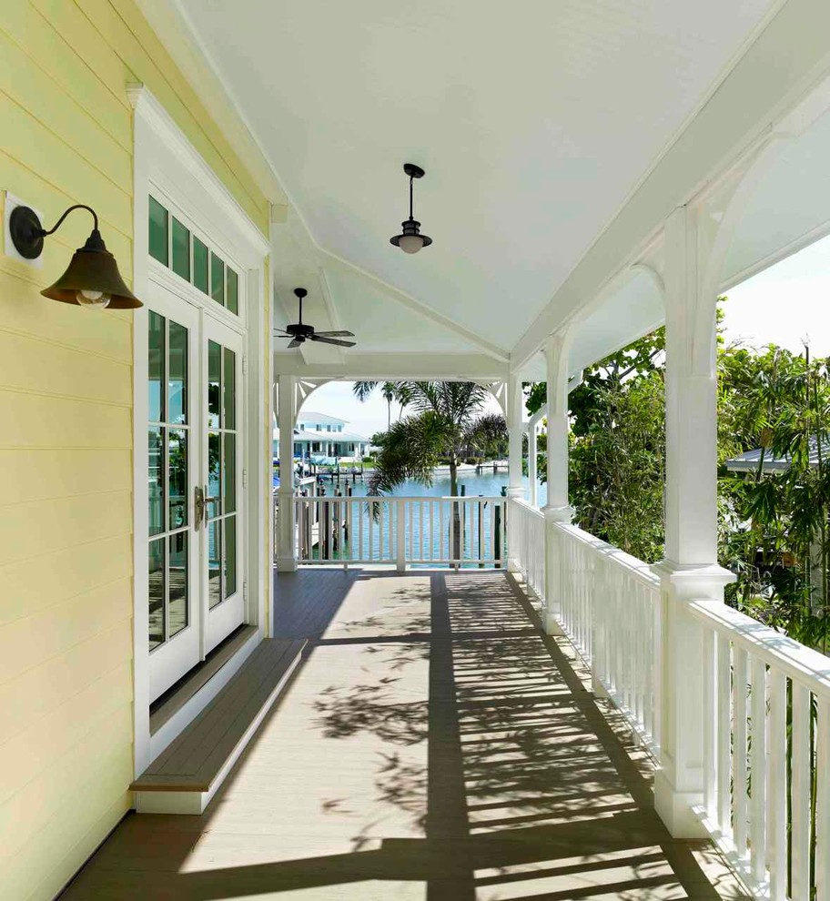 Elegant porch photo in Tampa with decking and a roof extension