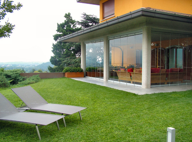 Patio Closed Off With Folding Glass Doors, Water And Airproof  Contemporary Porch