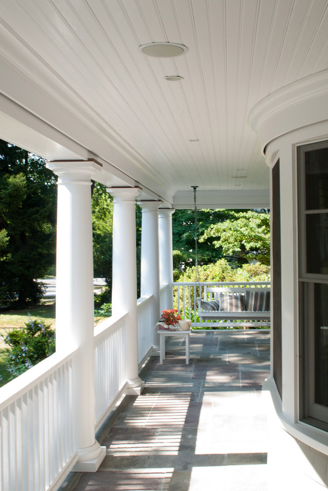 Ornate front porch photo in New York