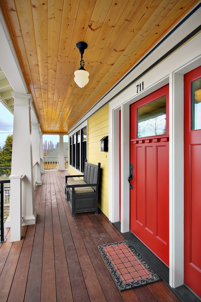 This is an example of a craftsman porch design in Seattle with decking and a roof extension.