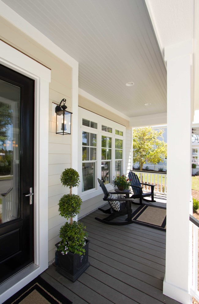 This is an example of a mid-sized traditional porch design in Wilmington with decking and a roof extension.