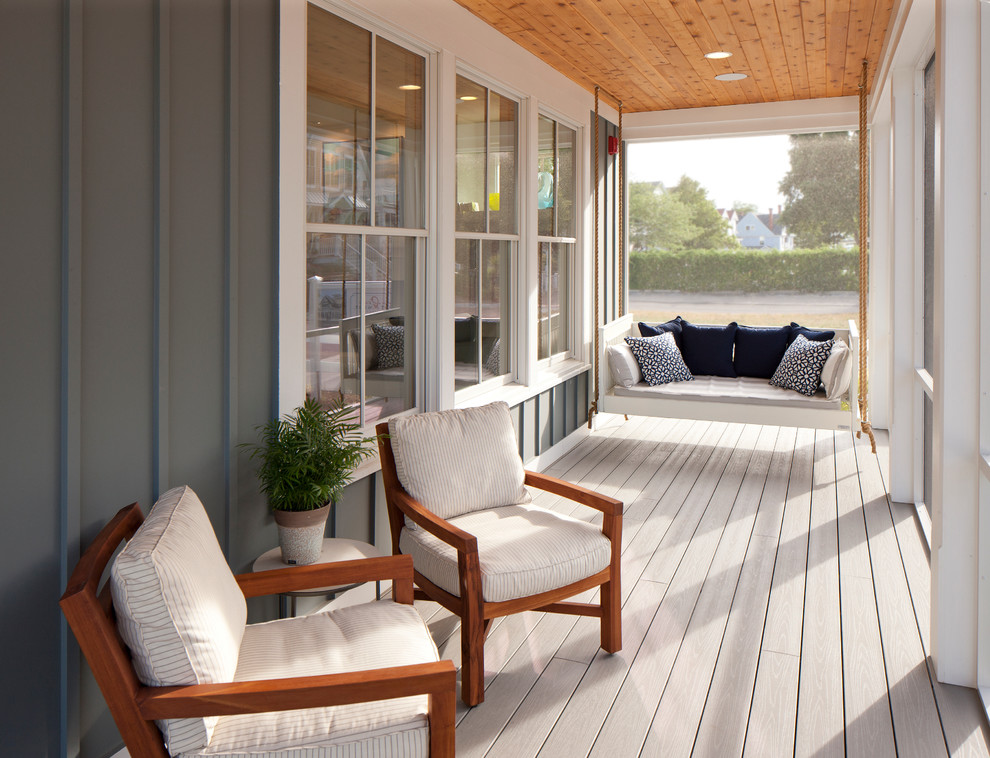 Beach style screened-in porch photo in Grand Rapids with decking and a roof extension