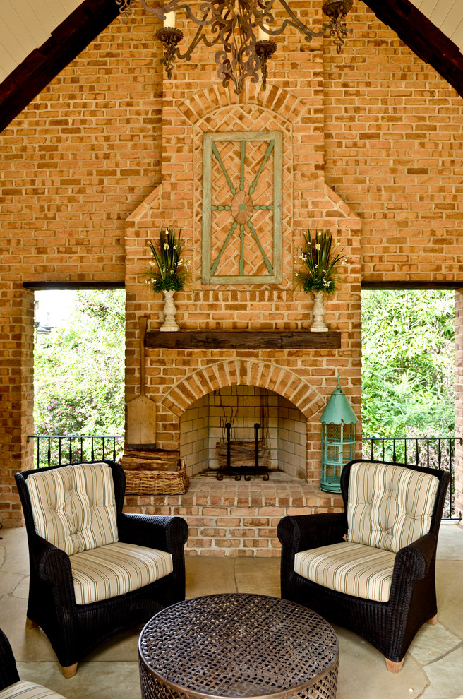 Inspiration for a large timeless stone back porch remodel in Atlanta with a fire pit and a roof extension