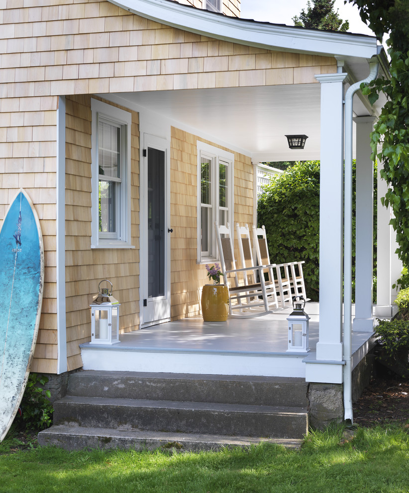 Beach style porch idea in Providence with decking and a roof extension