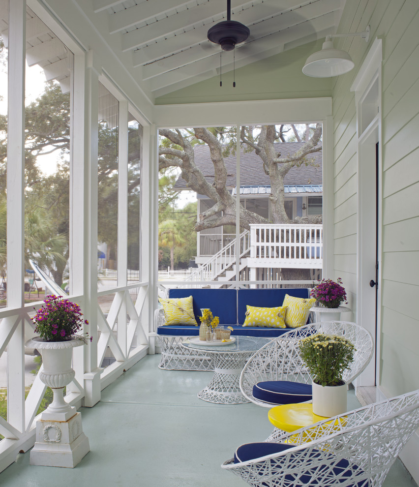Inspiration for a mid-sized coastal concrete screened-in front porch remodel in Atlanta with a roof extension