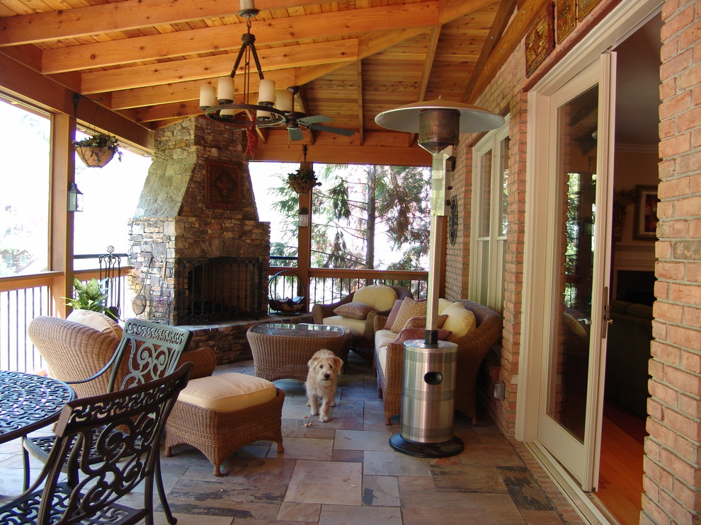 Inspiration for a timeless porch remodel in Atlanta with a fire pit