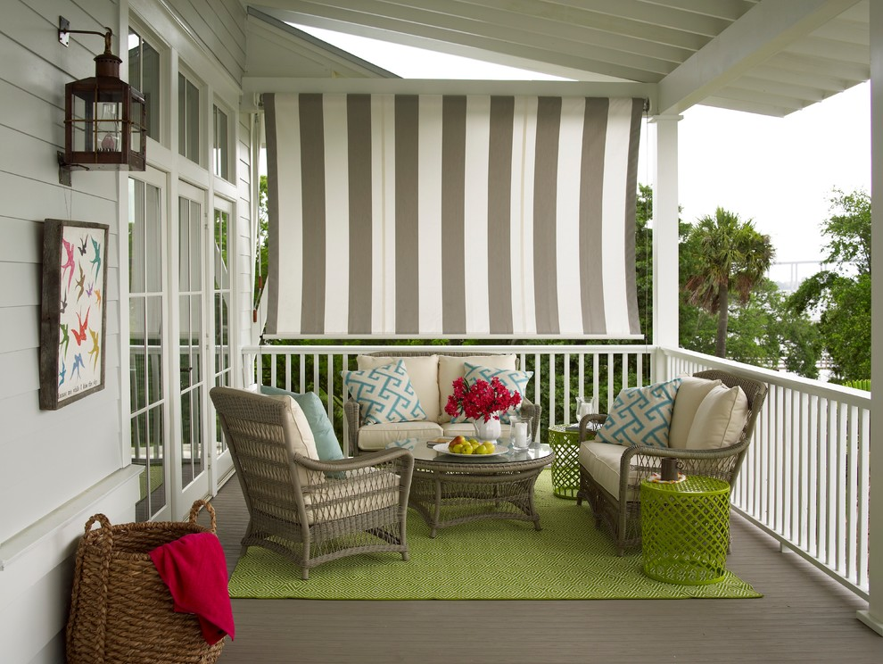 Inspiration for a transitional porch remodel in Charleston with decking and a roof extension