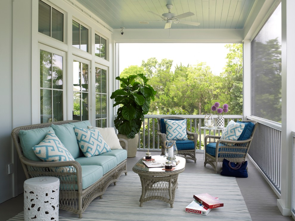 Inspiration for a coastal screened-in porch remodel in Charleston with decking and a roof extension