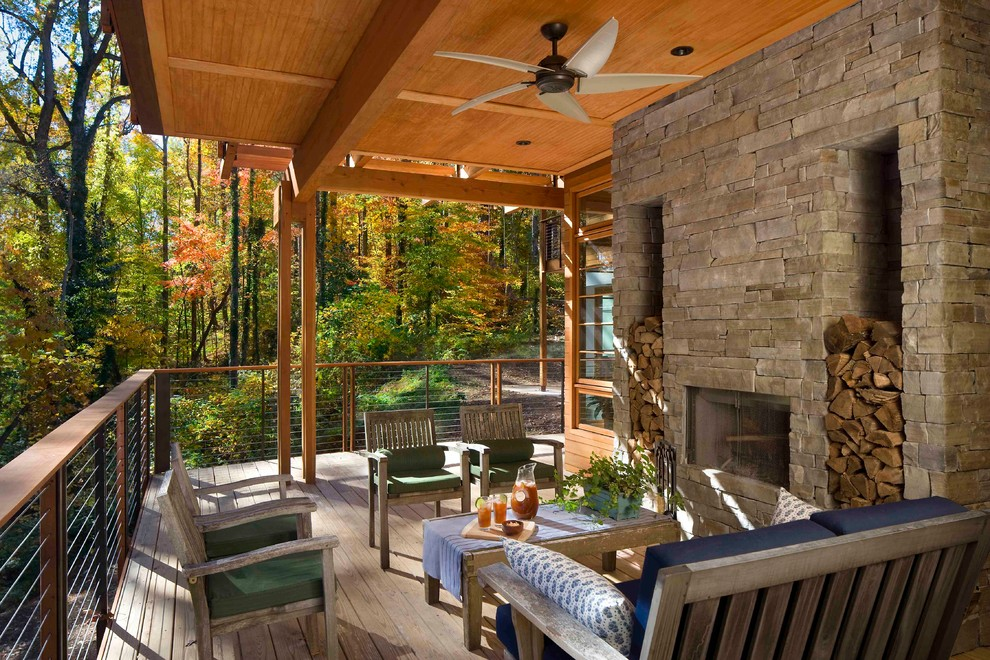 This is an example of a large rustic back porch design in Atlanta with a fire pit, decking and a roof extension.