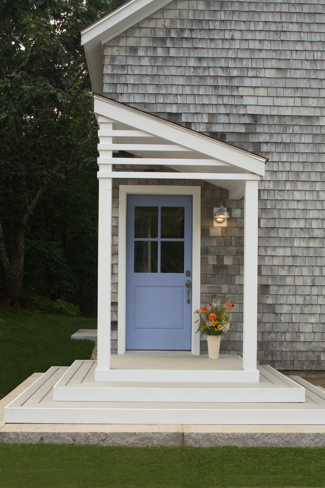 Elegant porch photo in Portland Maine with a roof extension
