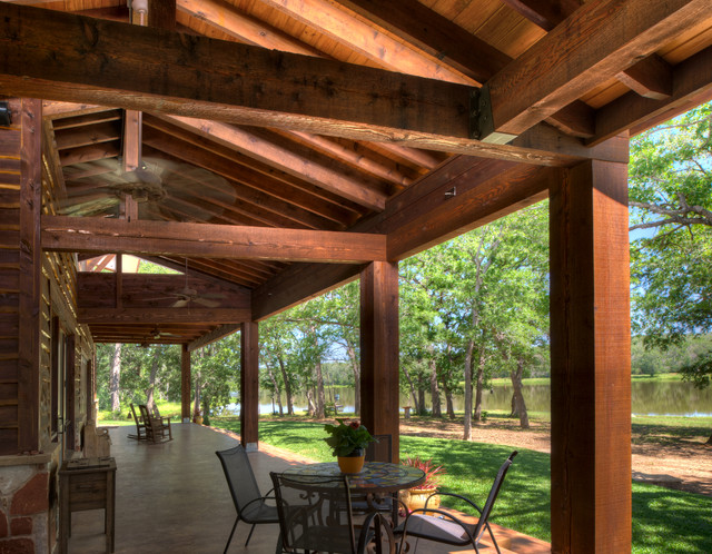 Ranch style by the lake rustic porch houston by for Custom rustic homes
