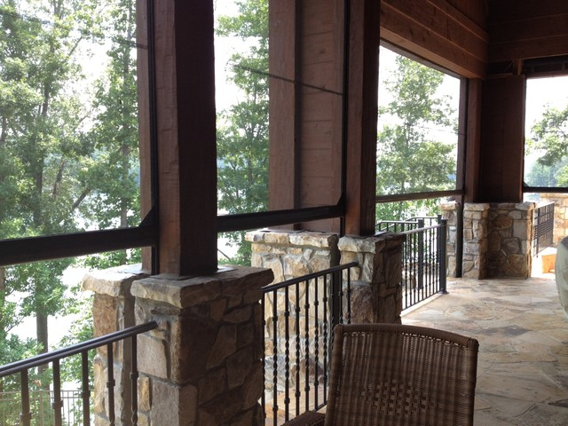 Phantom retractable screens on lake house traditional for Motorized retractable screens for porches