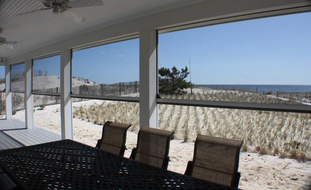 Retractable screens at beach front home, Mantaloking, NJ contemporary-porch
