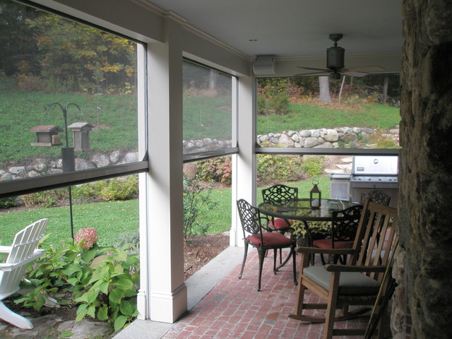 Retractable screens at classic new england farmhouse Motorized porch screens