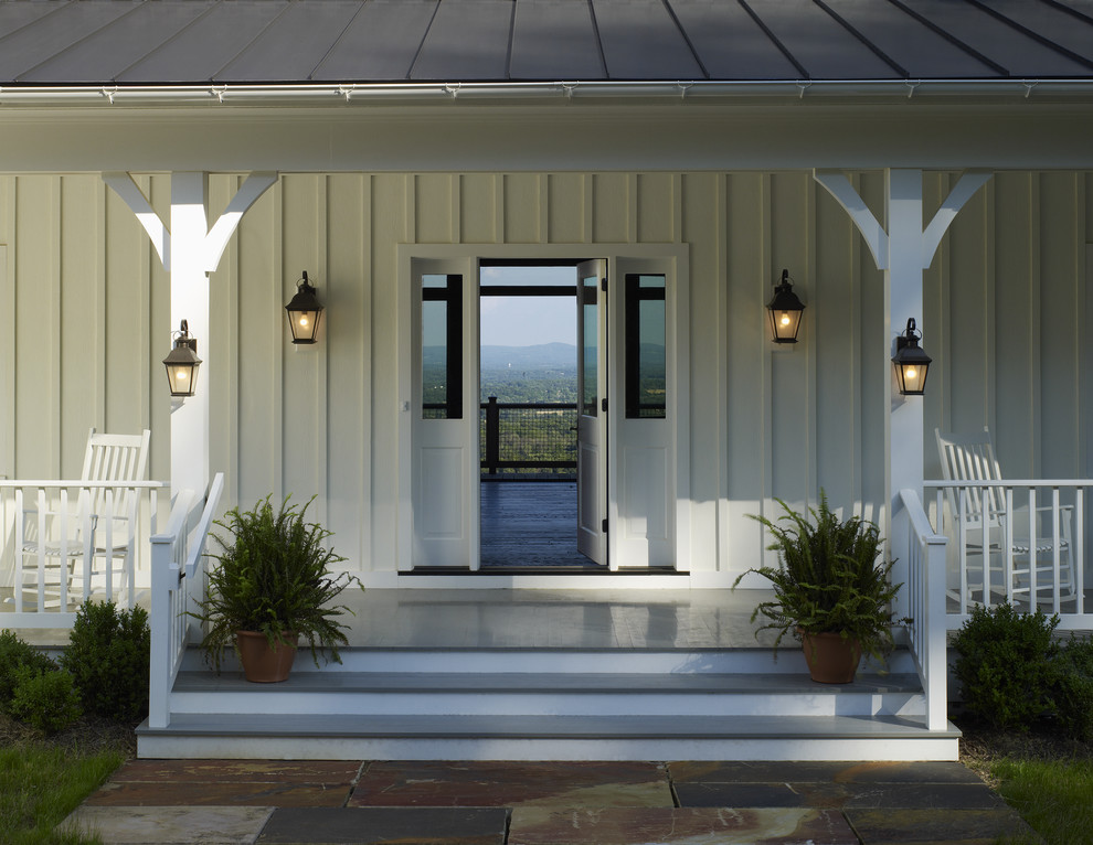 Farmhouse porch photo in DC Metro with a roof extension