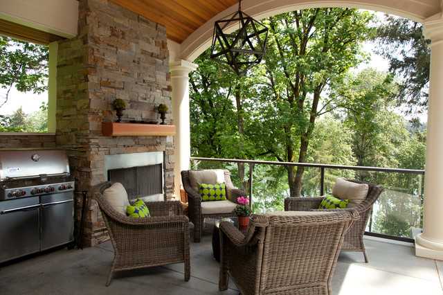 Mid-sized elegant concrete back porch photo in Portland with a fire pit and a roof extension