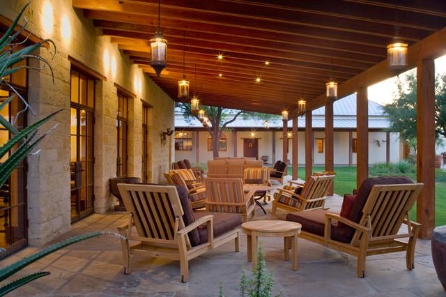 Rustic hacienda style texas ranch southwestern porch - Ranch americain poet interiors houston ...