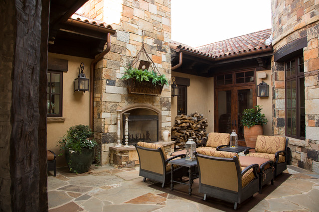 Rustic lodge style home rustic porch houston by for Rustic style homes