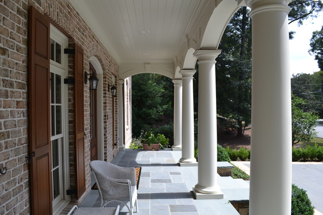 Inspiration for a mid-sized timeless tile front porch remodel in Atlanta with a roof extension