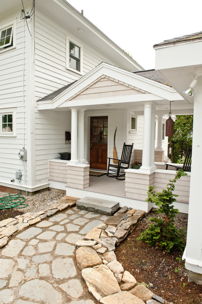 This is an example of a traditional porch design in Portland Maine with a roof extension.