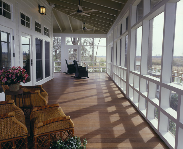 Screen porch farmhouse porch charleston by for Homes with verandahs all around