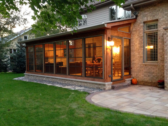 Screen porch with fireplace patio with fire pit rustic for Backyard sunroom