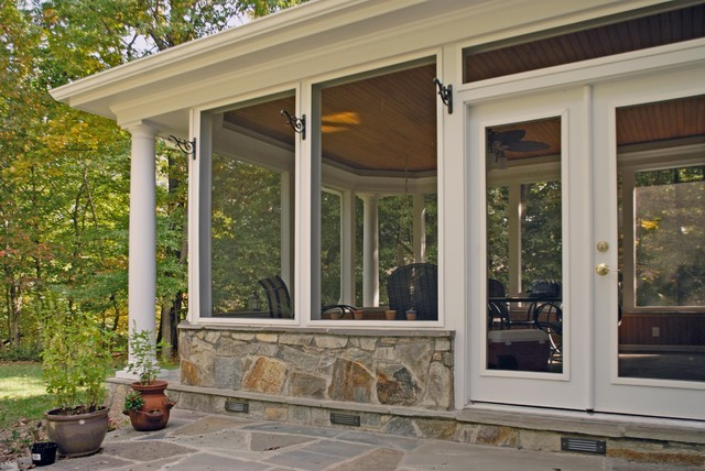 Screen porch with stone base traditional veranda for Screened in porch lanai