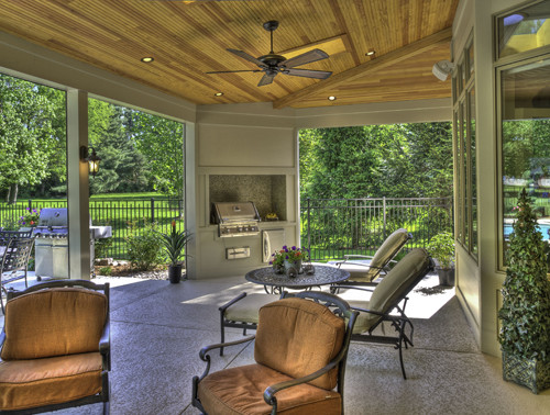 Classic stamped concrete porch idea in St Louis with a roof extension